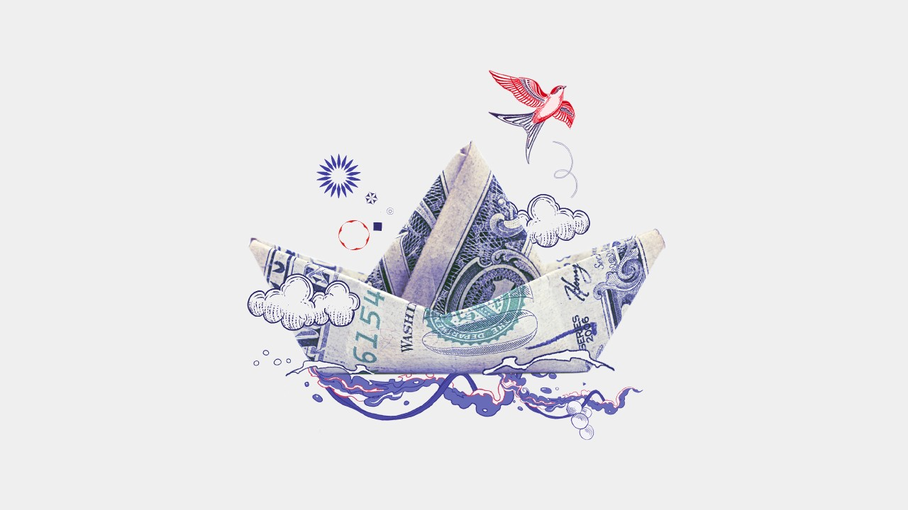 A ship folded from banknote, with illustrations of waves, a cloud and a bird.